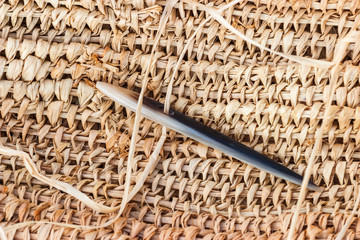Weave with an old prehistoric needle