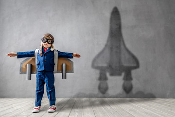 Happy child wants to fly. Imagination, freedom and motivation concept Fotomurales