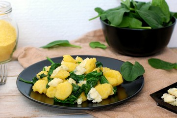 Wall Mural - Sweet corn polenta gnocchi wiht spinach and cheese