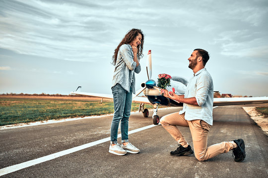 Romantic offer to get married. Man makes an offer to his girlfriend in airdrome.