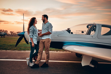 Couple in love staying near aircraft