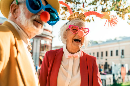 Beautiful elderly woman in a funny suit laughing
