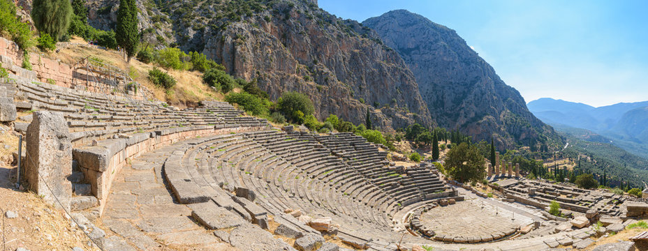 Ancient theatre of Delphi with temple of Apollo at the background, panoramic view