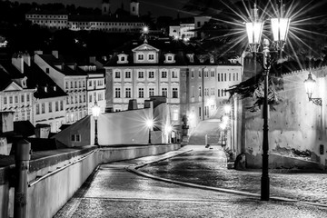 The street in Prague in the light of lanterns. Vintage view. Old retro style.