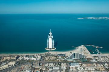 Keuken foto achterwand Dubai Aerial view from a plane of Dubai Jumeirah district cityscape and world islands on a sunny day. Dubai, United Arab Emirates.