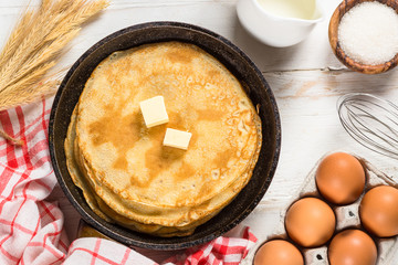 Acrylic Prints Countryside Crepes or thin pancakes in the frying pan with ingredients for cooking.