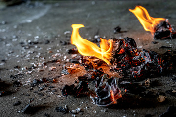 Picture of a fire burning paper on the ground