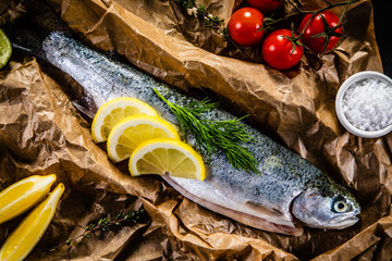 Fresh raw trout and vegetables