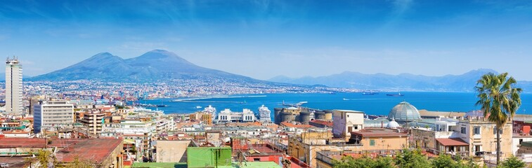 Panoramic view of Naples, Italy. Castel Nuovo and Galleria Umberto I towering over roofs of neighboring houses of Naples.