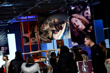 Shoppers walk past images of pop star Beyonce at an Adidas store on Oxford Street in London, Britain