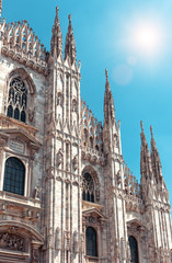 Fototapete - Milan Cathedral (Duomo di Milano) in sunlight, Italy. It is top landmark of Milan. Luxury facade of Milan Cathedral. Sunny view of old Gothic decorations.