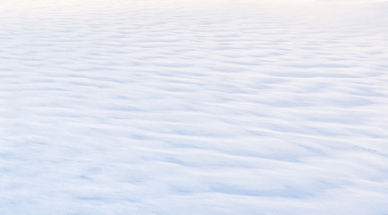 Background of pure snow texture. Minimalist winter landscape. Ice and snow cover on frozen river.  Panoramic view of white snowy surface like desert.