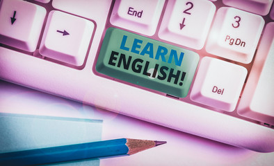 Writing note showing Learn English. Business concept for gain acquire knowledge in new language by...