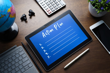 Business concept - Action Plan list write on PC tablet