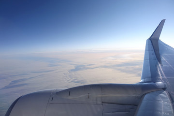 flight above the clouds, aerial view from plane
