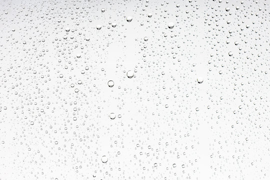 white isolated background water drops on the glass / wet window glass with splashes and drops of water and lime, texture autumn background