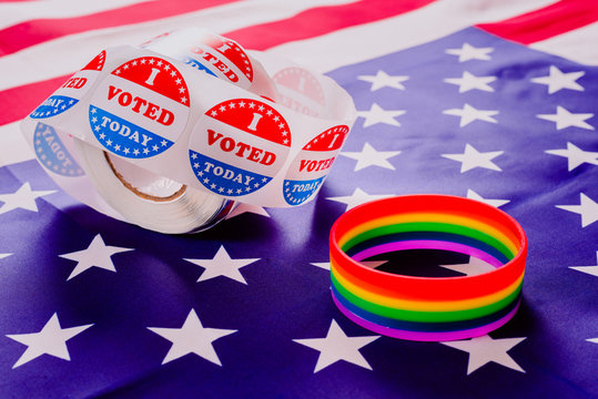 American flag and gay pride rainbow bracelet as a message in the US political elections.