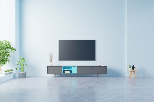 TV on the cabinet in modern living room on blue wall background.
