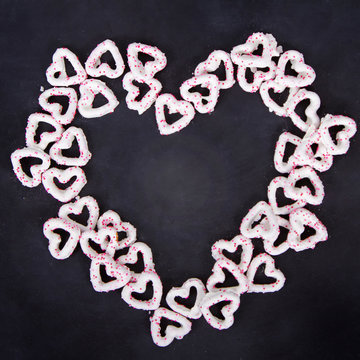 Heart shaped white chocolate covered pretzels