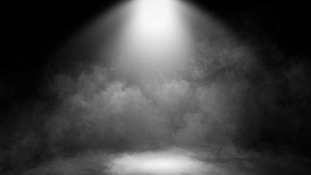 Divine light through a dark fog. The rays beam light on the floor. Spotlight on isolated background.