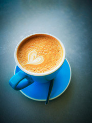 Blue mug of coffee with a love heart