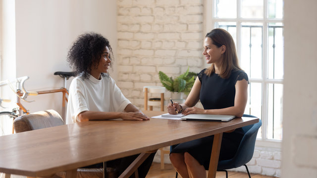 Happy businesswoman hr manager holding interview with job applicant