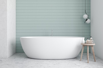Blue and white bathroom interior with tub