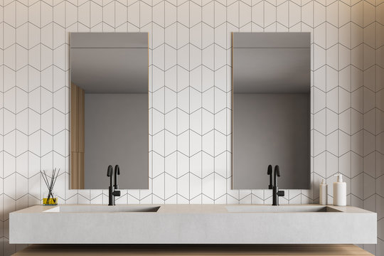 White tile bathroom interior with double sink