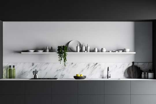 Gray countertops in white marble kitchen