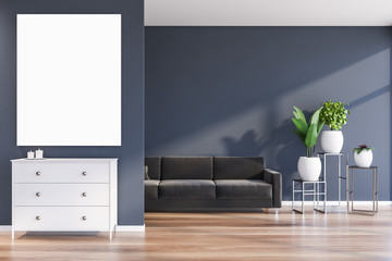 Blue living room with sofa and poster