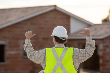 Professional engineer architect worker with protective helmet at house building construction site background
