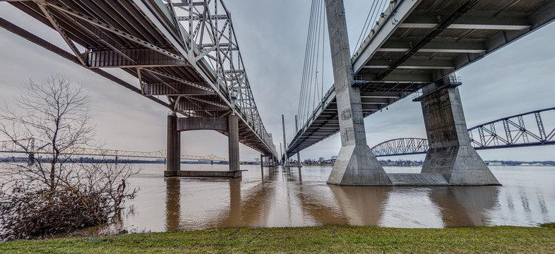 Ground perspective view on John F. Kennedy Memorial Bridge and Abraham Lincoln Bridge in Louisville during daytime