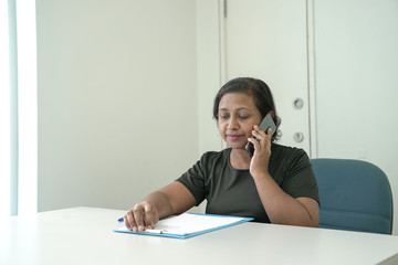 Hiring manager conducting an interview over the phone