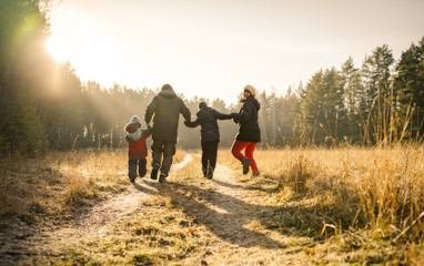 happy family walking on country road