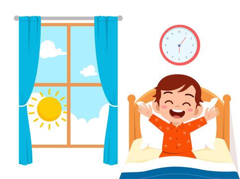 happy cute little kid boy wake up