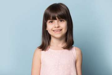Little pretty smiling girl head shot studio portrait.