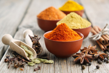 Aromatic spices and herbs: red pepper, turmeric, cardamom, cinnamon, cloves, anise, paprika. Ingredients for cooking. Ayurveda treatments