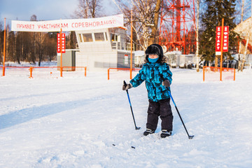 boy goes skiing on the starting field