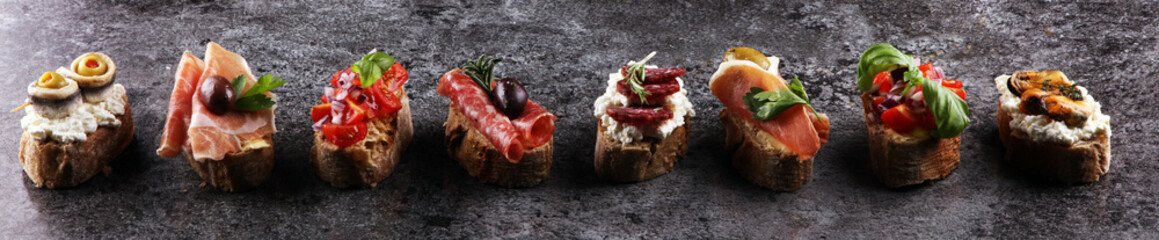 Appetizers table with italian antipasti snacks and wine in glasses. Brushetta or authentic traditional spanish tapas set, cheese variety Wall mural