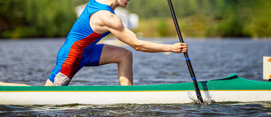 close up athlete canoeist rowing canoeing competition race