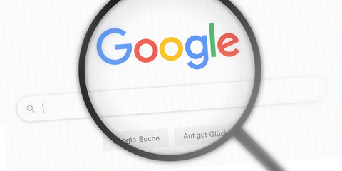 GERMANY - JAN 19, 2020: google.de - website logo / screen under magnifying glass. google search engine / the most used search engine on the world wide web. search bar / editorial banner / close-up.