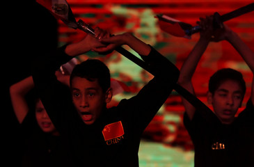 """Egyptian children at Chinese training fighteen school, are seen during a performance in Chinese Lunar New Year """"China's 2020 Spring Festival"""" celebrations by the Chinese Cultural Center in Cairo (CCC) at El Gomhoria Theater in Cairo"""