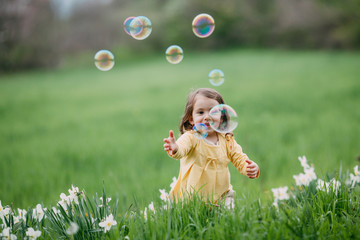 Little girl and beautiful bubbles