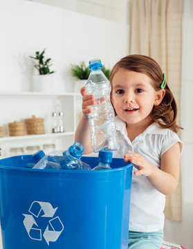 Little girl doing recycling at home