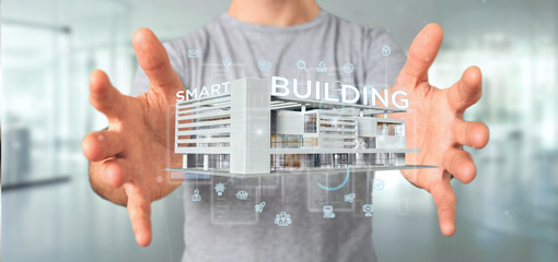 Businessman holding a Smart building connected - 3d rendering