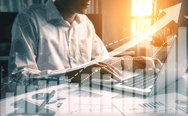 Fototapeta Double Exposure Image of Business and Finance - Businessman with report chart up forward to financial profit growth of stock market investment.