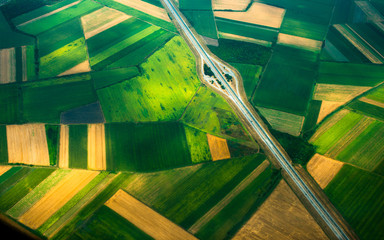 Fototapeta aerial photo from a plane, top view, road through the fields