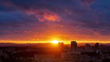 Sunset timelapse clouds colorful and building photo Fotobehang