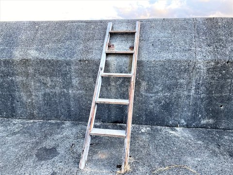 The ladder hung on an embankment.