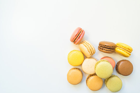 Sweet and colourful french macaroons or macaron on background, Dessert.